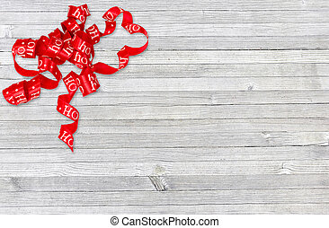 curly Christmas ribbon on old wood