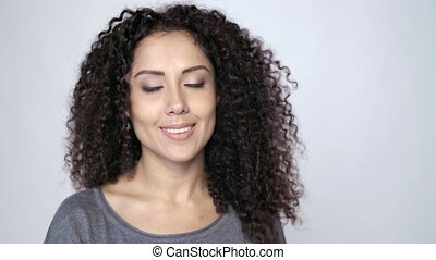 Curly female gesturing thumb up - Beautiful curly female...