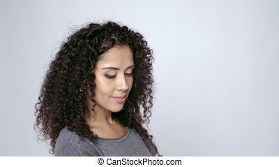 Curly female looking at blank copy space - Beautiful curly...