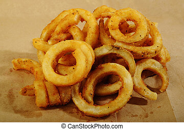 Curly Fries on brown paper background