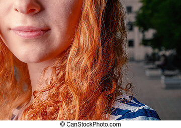 Curly ginger hairs and low part of the face closeup