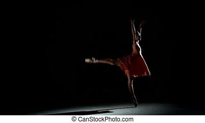 curly girl dancing ballet in studio