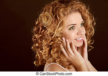 Curly Hair. Attractive smiling woman portrait on dark background. Beauty Portrait.