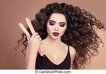 Curly hair. Beauty Close-up of brunette girl with blowing ...