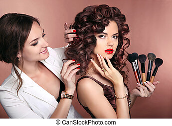 Curly hair. Beauty makeup