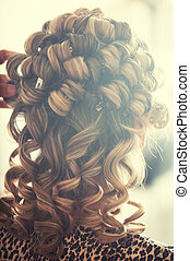 curly hair - Blonde girl doing a perm hair salon