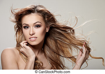 Curly hair - Young brunette lady with a beautiful hair on...