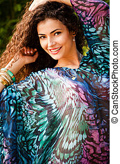 curly hair woman - curly hair smiling woman portrait outdoor...