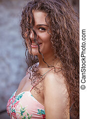 Curly hair woman portrait outdoor
