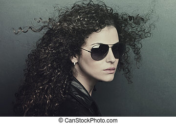 curly hair woman with sunglasses - curly hair young woman...