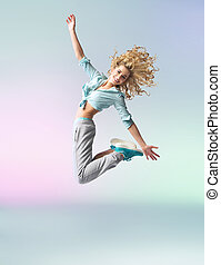 Curly-haired athlete woman jumping and dancing -...