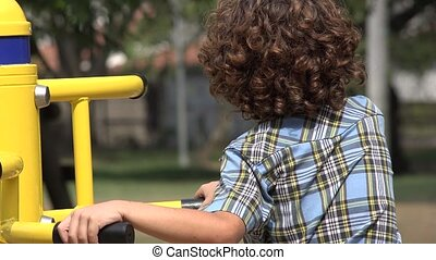 Curly Haired Boy at Playground