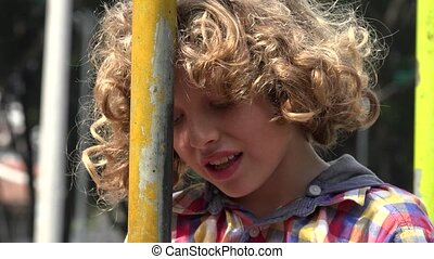Curly Haired Boy During Summer