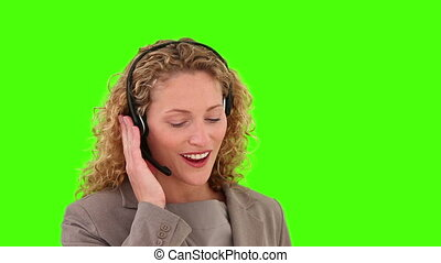 Curly-haired fenmale speaking though the headset -...