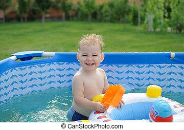 Curly haired girl in backyard pool