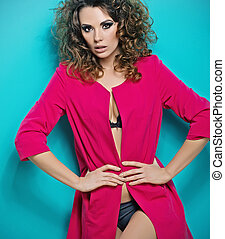 Curly-haired woman wearing pinky coat