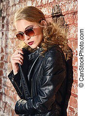 curly hairstyle - Modern young woman over urban background....