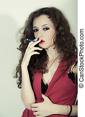 curly long-haired brunette woman with cigarette