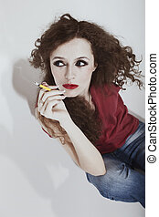 curly long-haired brunette woman with yellow cigarette