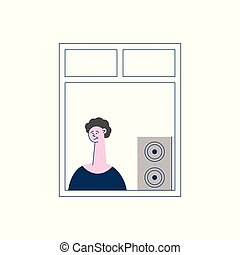 Curly man or boy brunet stands and windows and listens to music from a column or subwoofer