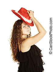 Curly woman in red hat
