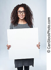 Curly woman with whiteboard