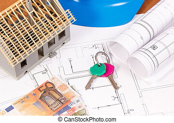 Currencies euro, home keys, electrical diagrams for engineer jobs and house under construction on desk