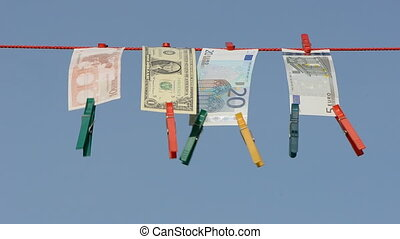currency banknote on clothes-line after money-laundering