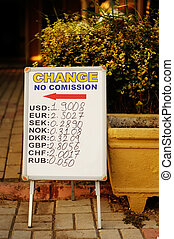 Currency exchange rates board at street.