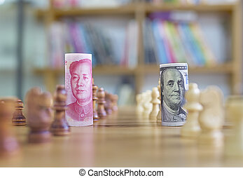 currency war - China's yuan vs US dollar in chess concept