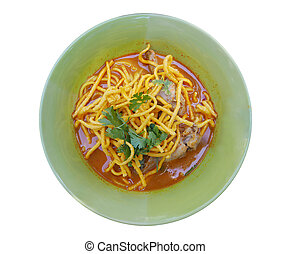 Curried Noodle Soup with Chicken (Khao Soi) in green bowl isolated