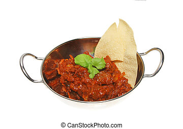 Curry and pappadum in balti dish