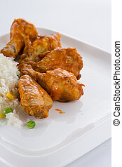 Curry chicken with rice on a white plate