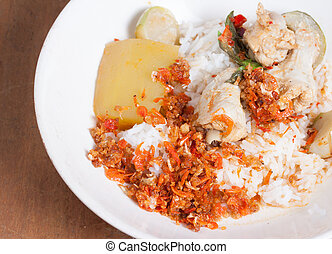 Curry chicken with  rice.