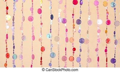 Curtain fragment made of varicoloured plastic beads