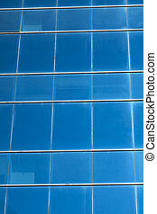 Curtain Wall - Dark blue office building's curtain wall made...