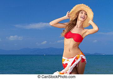 Curvaceous woman in bikini