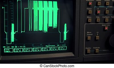 Curve appear on screen of oscilloscope, hand push some buttons