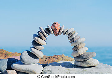 Curve arc of the pebbles on the boulders