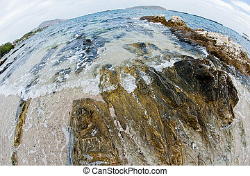 curve of sea and wave on the rock