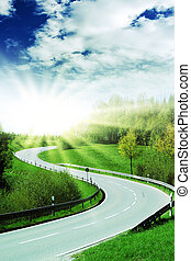 curve of a highway with bright sun
