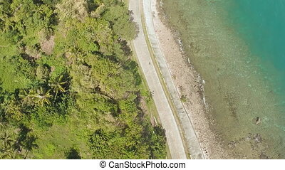 Curve winding road along the coast of the Philippines. Aerial views.