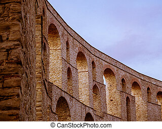 Curved ancient Roman aqueduct in center of Kavala city - Greece
