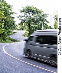 Curved asphalt road in high mountains, Thailand