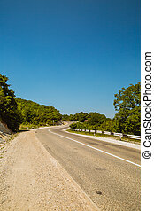 Curved asphalt road in mountains