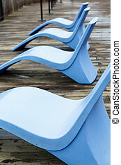Curved Blue Chairs on Pier