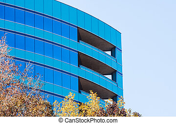 Curved Blue Glass Building and Sky in Fall