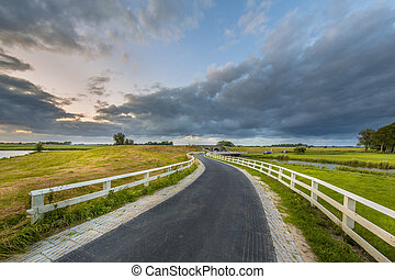 Curved country road in Reitdiepgebied - Curved Asphalt...