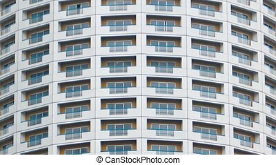 Curved Facade of an Unusual Urban Highrise Building. FullHD...