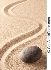 curved line in the sand of a zen stone garden